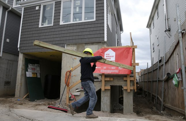 Construction workers repair homes damaged by Hurricane Sandy just a few days before the five-year anniversary of Hurricane Sandy in Broad Channel, N.Y., on Thursday. Photo by John Angelillo/UPI