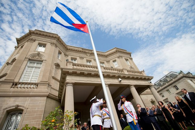A Cuban flag is raised at its new embassy in Washington, D.C., in 2015. Wednesday, the Trump administration announced new policy restrictions involving U.S. travel to the island will become effective on Thursday. File Photo by Andrew Harnik/UPI/Pool