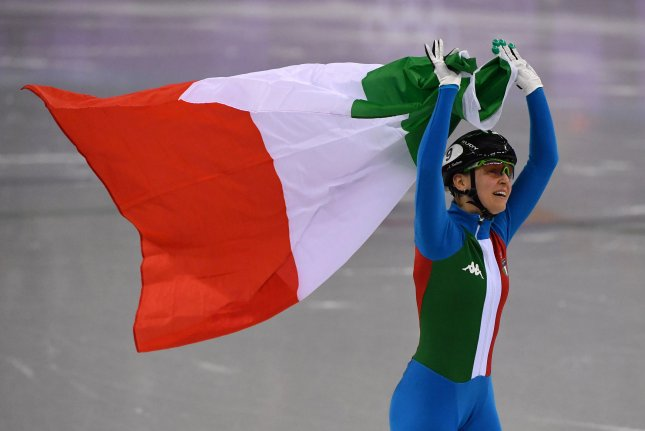 Arianna Fontana of Italy takes a victory lap after winning the gold medal in the Ladies' 500m Short Track Speed Skating event on Tuesday during the Pyeongchang 2018 Winter Olympics, at the Gangneung Arena in Gangneung, South Korea. Photo by Richard Ellis/UPI