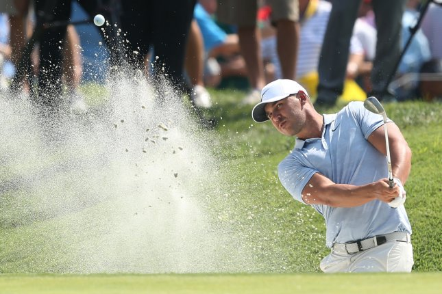 PGA golfer Brooks Koepka hits out of a bunker on the sixth hole during the third round of play of the PGA Championship on Saturday at Bellerive Country Club in Town and Country, Mo. Photo by Bill Greenblatt/UPI
