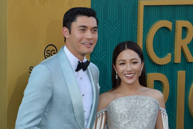 Constance Wu (R) and Henry Golding play Rachel Chu and Nick Young in Crazy Rich Asians. File Photo by Jim Ruymen/UPI