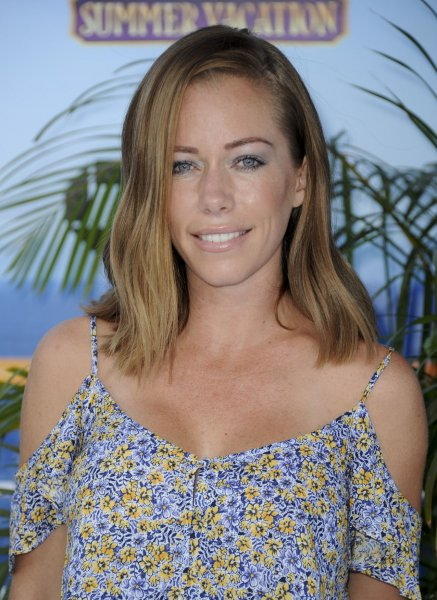 Kendra Wilkinson responded on Instagram after some suggested she got her boob job to attract men and attention. File Photo by Patrick Rideaux/UPI