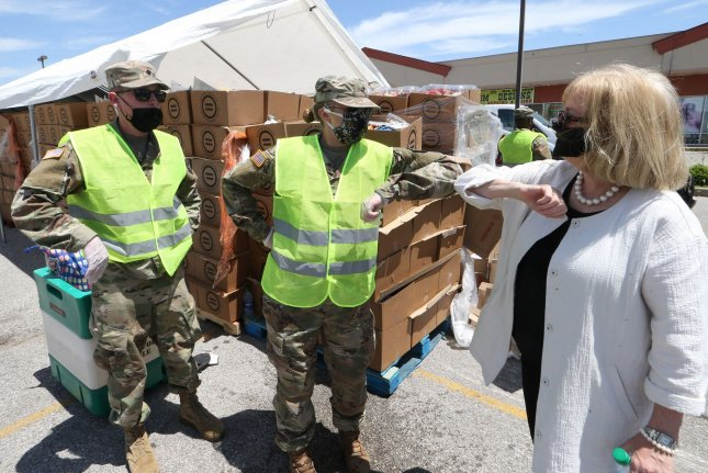St. Louis Mayor Lyda Krewson communicates with members of the Missouri National Guard last Saturday at a food giveaway in St. Louis, Mo. Photo by Bill Greenblatt/UPI