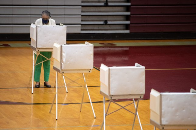 A voter wearing a protective mask casts their ballot during the District of Columbia primary election at a polling location in Washington on June 2. File photo by Kevin Dietsch/UPI