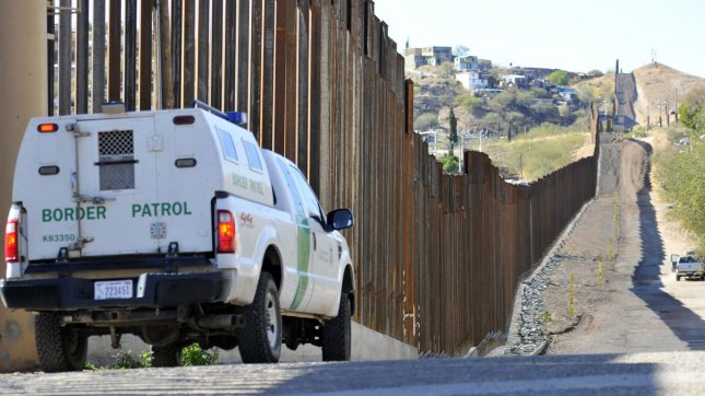 A Boarder Patrol truck sits along the boarder fence between the United States and Mexico. The Fast and Furious gun walking operation was first uncovered following the death of Border Patrol Agent Brian Terry who was gunned down by two men armed with at least two semi-automatics trafficked by Fast and Furious suspects. UPI /Art Foxall