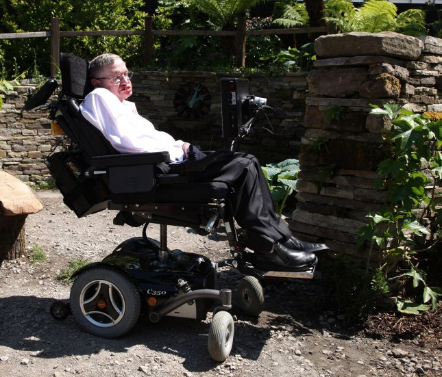 Astro physicist Stephen Hawking sits in a garden in London May 24, 2010. UPI/Hugo Philpott