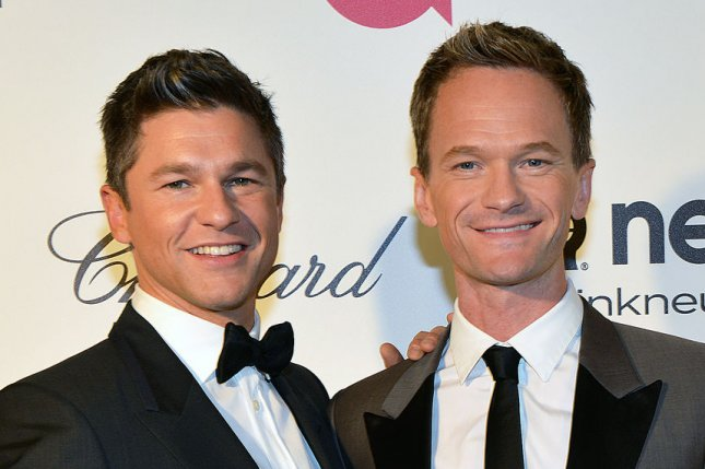 Actor Neil Patrick Harris (R) and his partner David Burtka arrive for the Elton John AIDS Foundation Academy Awards Viewing Party at West Hollywood Park in Los Angeles on March 2, 2014. UPI/Christine Chew