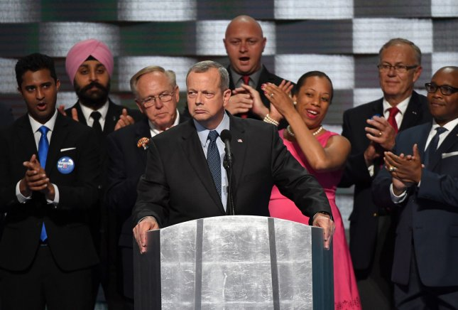 Retired General John Allen, appearing with several veterans, addresses delegates during the Democratic National Convention at the Wells Fargo Center in Philadelphia, Pa., on July 28, 2016. Allen's name is on the list of 95 former generals and admirals who support Clinton that was released Wednesday. File photo by Pat Benic/UPI