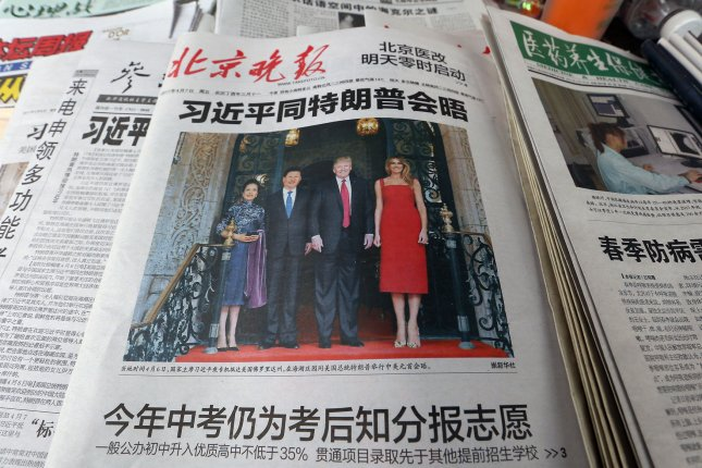 A prominent Chinese national newspaper, featuring a front-page story on China's President Xi Jinping's first meeting with U.S. President Donald Trump. Photo by Stephen Shaver/UPI