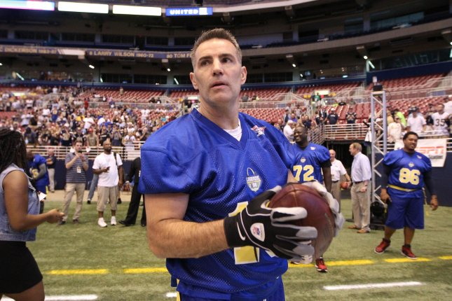 Former Arizona Cardinals quarterback Kurt Warner warms up before playing in a charity flag football game last year. Photo by Bill Greenblatt