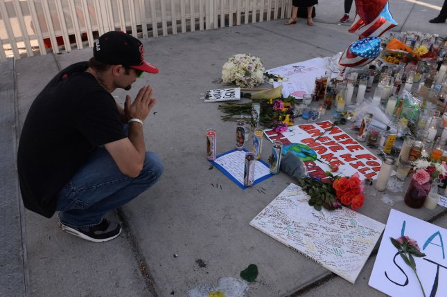 Las Vegas resident Brandon Newhart prays at a makeshift memorial for the victims of one of the deadliest mass shootings in U.S. history in Las Vegas on Tuesday. Fifty-nine people were killed and hundreds injured late Sunday at an outdoor country music festival on the Las Vegas Strip. Photo by Jim Ruymen/UPI