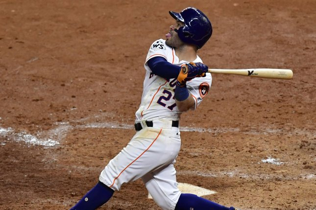 Houston Astros second baseman Jose Altuve hits a game tying three-run home run against the Los Angeles Dodgers in the fifth inning in the 2017 MLB World Series game five at Minute Maid Park in Houston, Texas on October 29, 2017. File photo by David Tulis/UPI