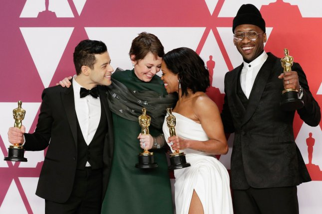 Oscar winners, left to right, Rami Malek, Olivia Colman, Regina King and Mahershala Ali pose with their trophies in Los Angeles on February 24. More than 300 movies qualify for Oscar consideration for the next edition of the Academy Awards. File Photo by John Angelillo/UPI