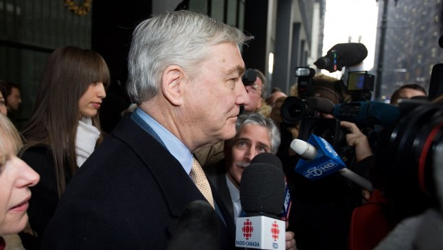 Former Media Mogul Conrad Black (R) leaves federal court with his daughter Alana after being sentenced to 78 months in prison on December 10, 2007, in Chicago. Black was convicted in July of three counts of mail fraud and obstruction of justice for his role in a scheme which bilked shareholders out of millions of dollars. (UPI File Photo/Brian Kersey)