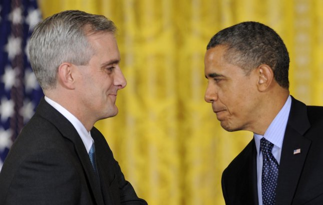 US President Barack Obama (R) shakes hands with newly-named Chief of Staff Denis McDonough, in the East Room of the White House, January 25, 2013, in Washington, DC. McDonough, formerly deputy national security adviser, replaces Jack Lew, who was nominated as the next Treasury Secretary. -- UPI/Mike Theiler