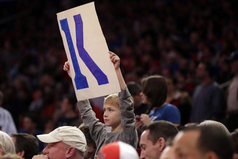 Fans hold up K signs for Duke Blue Devils coach Mike Krzyzewski. Photo by John Angelillo/UPI