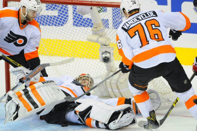 Philadelphia Flyers goalie Michal Neuvirth (30) makes a save on a shot. During Saturday's game, Michal Neuvirth collapsed in the crease. File photo by Mark Goldman/UPI