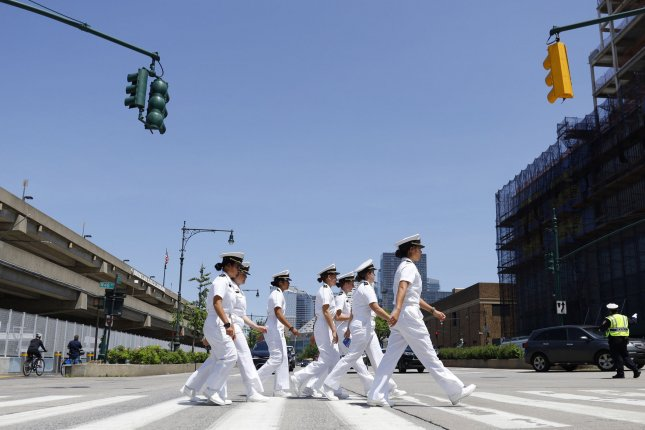 Women of the United States Navy cross the West Side Highway. A two-year commission determined women should be eligible for the draft. File Photo by John Angelillo/UPI
