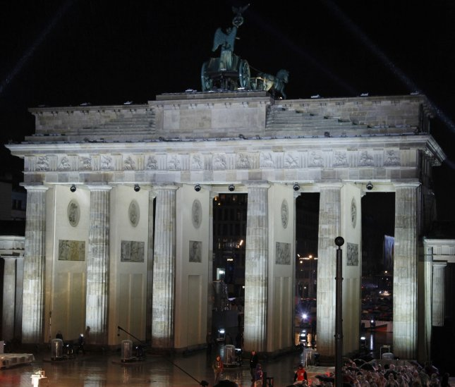 The Brandenburg Gate is seen before the start of a ceremony commemorating the 20th anniversary of the fall of the Wall in Berlin on November 9, 2009. On June 20, 1991, the German Parliament voted to move its capital from Bonn to Berlin. File Photo by David Silpa/UPI