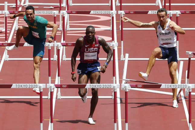 Grant Holloway of the United States (C) won silver in the men's 110-meter hurdles finals on Thursday during the Tokyo Summer Olympics in Tokyo, Japan. Photo by Bob Strong/UPI
