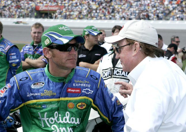 Clint Bowyer (L) and car owner Richard Childress wait on pit road for the start of the NASCAR Nationwide Camping World 300 on Feb. 14, 2009. (UPI Photo/Chad Cameron)