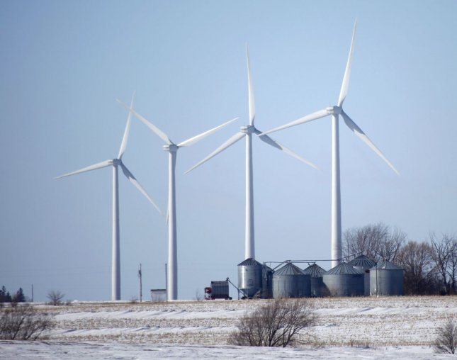Windmills spin on a wind farm near Charles City, Iowa on February 2, 2009. The Obama administration's stimulus plan will boost the U.S. wind-power industry by paying for new transmission lines according to Emerging Energy Research, an energy consulting firm located in Cambridge, Massachusetts. Iowa recently surpassed California as the nation's second largest wind power producer. (UPI Photo/Brian Kersey)