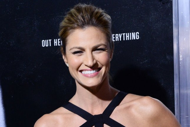 Erin Andrews sparked engagement rumors by wearing an enormous diamond ring on the season 20 premiere of 'Dancing with the Stars.' File photo by Jim Ruymen/UPI