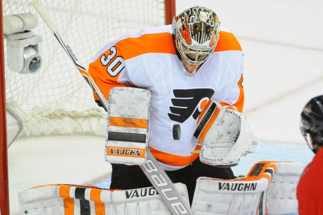 Philadelphia Flyers goalie Michal Neuvirth (30) makes a save on a shot. File photo by Mark Goldman/UPI