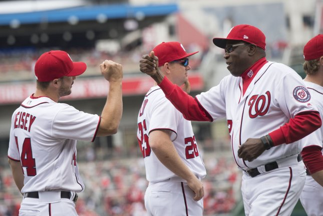 Washington Nationals manager Dusty Baker (12) greets teammates as he takes the field for the Nationals' season opener against the Miami Marlins at Nationals Park in Washington, D.C. on April 3, 2017. File photo by Kevin Dietsch/UPI