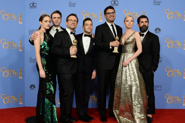 The Mr. Robot team -- Carly Chaikin, Martin Wallstrom, Christian Slater, Rami Malek, Sam Esmail, Portia Doubleday and Chad Hamilton -- attend the 73rd annual Golden Globe Awards in Beverly Hills on January 10, 2016. Several cast members attended Esmail's weekend wedding to actress Emmy Rossum. File Photo by Jim Ruymen/UPI
