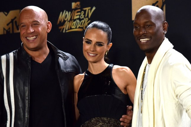 (L-R) Vin Diesel and Jordana Brewster, pictured with Tyrese Gibson, reunited on social media Wednesday alongside Fast and Furious director Justin Lin. File Photo by Christine Chew/UPI