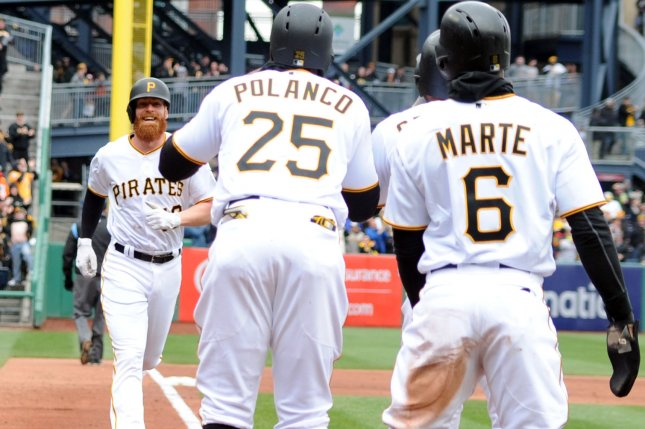 Pittsburgh Pirates third baseman Colin Moran (19) runs home to greet right fielder Gregory Polanco (25), center fielder Starling Marte (6) and catcher Francisco Cervelli (29) following his grand slam in the first inning against the Minnesota Twins on Opening Day on Monday at PNC Park in Pittsburgh. Photo by Archie Carpenter/UPI