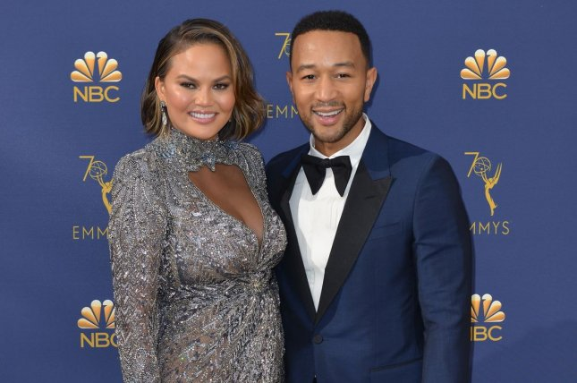 Chrissy Teigen (L), pictured with John Legend, shared details about her son and daughter in a new interview. File Photo by Christine Chew/UPI