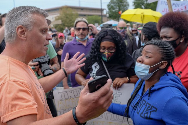 Civil rights activists argue with supporters of President Donald Trump's, during demonstrations in Kenosha, Wis., on September 1. Trump visited Kenosha a week after police shot Jacob Blake seven times in the back, despite city leaders asking him not to come. File Photo by Alex Wroblewski/UPI