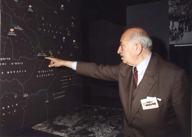 Simon Wiesenthal, the Holocaust survivor who helped track down Adolph Eichmann and other Nazi war criminals died September 20, 2005 in Austria at the age of 96. In this 1985 photo, Wiesenthal points to a map of concentration camps on a visit to Yad Vashem Holocaust Memorial in Jerusalem. (UPI Photo/HO)