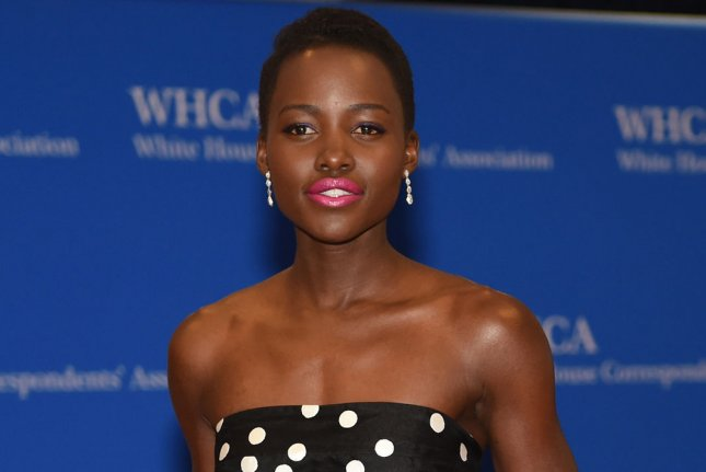 Actor Lupita Nyong'o arrives on the red carpet at the White House Correspondents' Association Dinner at the Washington Hilton in Washington, DC on May 3, 2014. UPI/Molly Riley