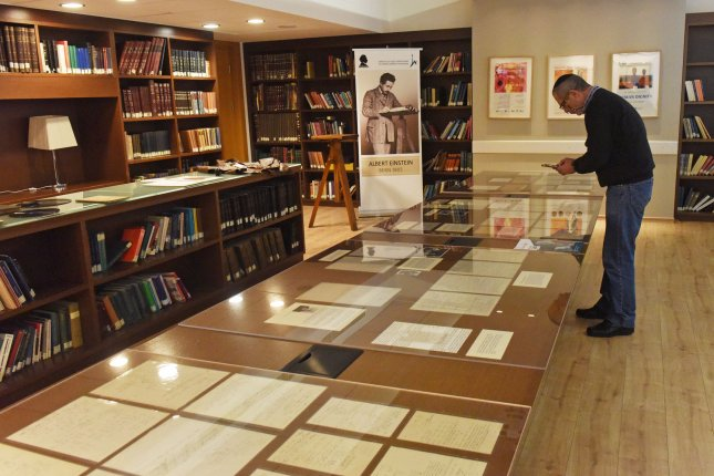 A visitor looks at a display of newly unveiled manuscripts of Albert Einstein's, both personal and scientific, at the Hebrew University in Jerusalem on Wednesday. Photo by Debbie Hill/UPI