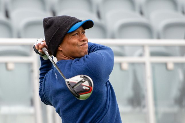 Tiger Woods hits from the 1st tee box during practice rounds at the PGA Championship on Monday at The Black Course at Bethpage State Park in Farmingdale, New York. Woods is being sued following the death of a The Woods restaurant employee. Photo by Corey Sipkin/UPI