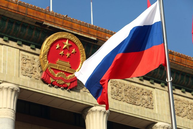 The Russian flag is seen outside the Great Hall of the People in Beijing, China. A study Thursday identified China and Russia as two nations that are most often involved in disinformation campaigns. File Photo by Stephen Shaver/UPI