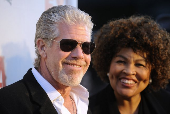 Ron Perlman (L) filed for divorce from Opal Stone Perlman six months after he was spotted kissing Allison Dunbar. File Photo by Phil McCarten/UPI
