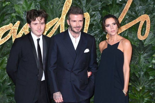 Brooklyn Beckham (L) and his parents David Beckham and Victoria Beckham attend the Fashion Awards in London in 2018. Brooklyn announced this weekend that he is engaged to Nicola Peltz. File Photo by Rune Hellestad/UPI