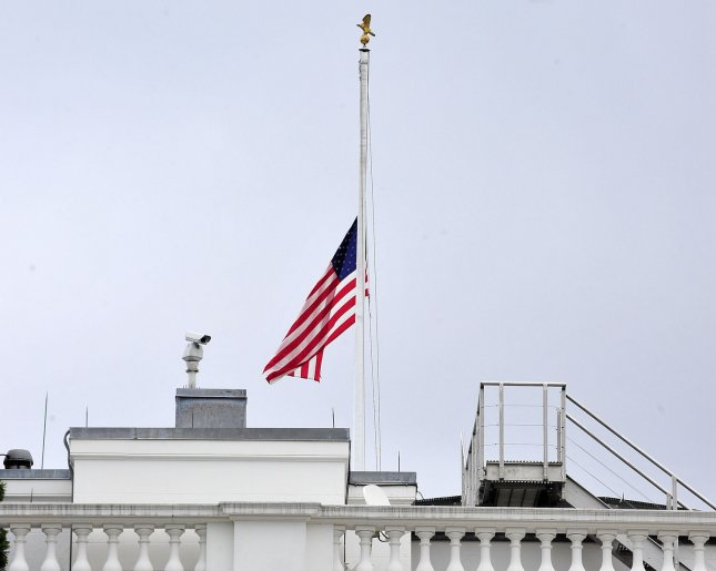 The American Flag that flies over the White House in Washington, D.C. flies at half-staff in remembrance of those killed in Aurora, Colorado on Friday, July 20, 2012. UPI/Ron Sachs/Pool