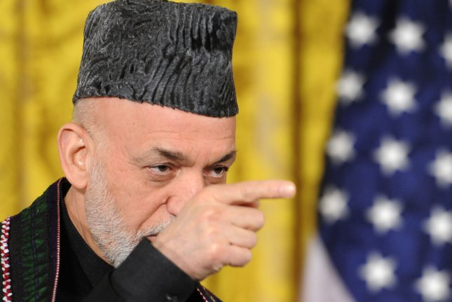 Afghan President Hamid Karzai points to a reporter during a press conference with US President Barack Obama in January 2013, in Washington, DC. The leaders were discussing a long-term US troop presence as American military forces considered a 2014 withdrawal date from Afghanistan. (UPI/Mike Theiler)