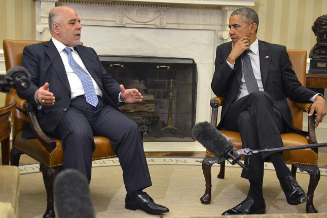 U.S. President Barack Obama (R) listens as Iraqi Prime Minister Haider al-Abadi makes remarks after a bilateral meeting in the Oval Office of the White House, April 14, 2015, in Washington, DC. The leaders discussed the strategic partnership between the two countries, support in fighting ISIL as well as commercial and cultural relations. Photo by Mike Theiler/UPI