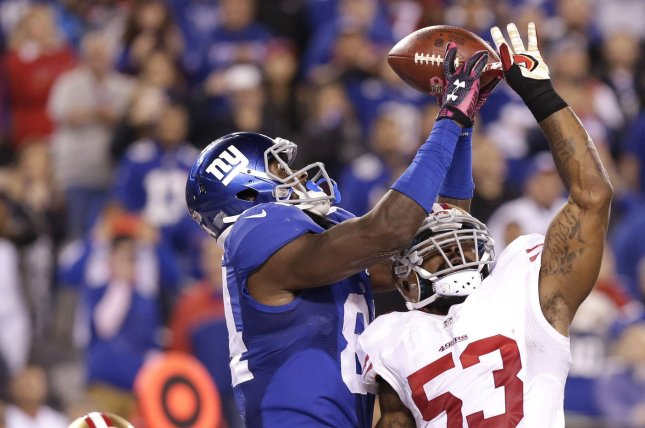 Larry Donnell catches a 12 yard game winning touchdown pass from Eli Manning in the final minute of the 4th quarter at MetLife Stadium in East Rutherford, New Jersey on October 11, 2015. The Giants defeated the 49ers 30-27. Photo by John Angelillo/UPI