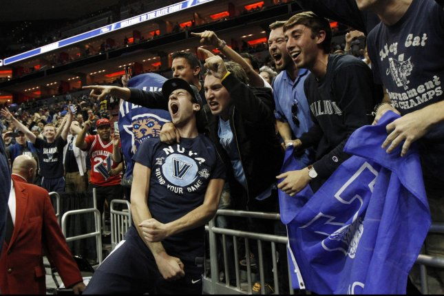 Villanova University's Ryan Arcidiacono (15) celebrates with fans after defeating the University of Kansas in the South Regional Championship of 2016 NCAA Division I Men's Basketball Championship at the KFC Yum! Center in Louisville, Kentucky, March 26, 2016. Photo by John Sommers II/UPI.