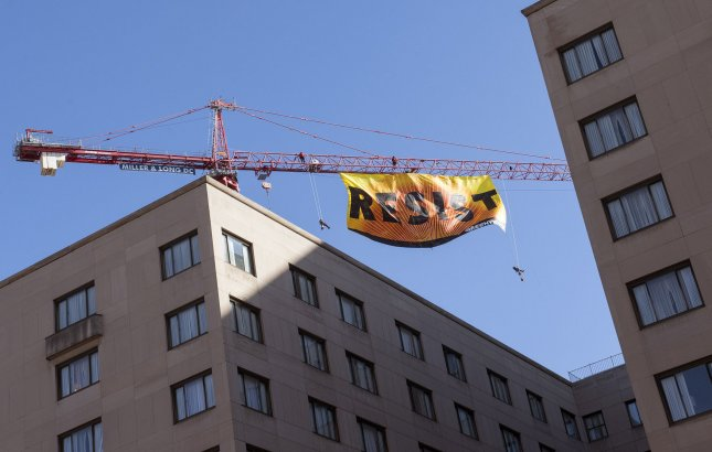 Greenpeace activists hang a banner reading Resist from a crane near the White House, in Washington, D.C., on January 25, 2017. Photo by Kevin Dietsch/UPI