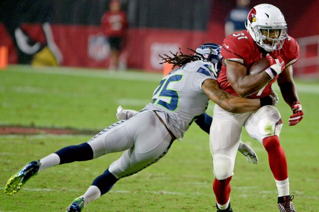 Arizona Cardinals' David Johnson (R) picks up a first down as Seahawks CB Richard Sherman tries to make a tackle in the in the second quarter of the Cardinals-Seattle Seahawks game at University of Phoenix Stadium in Glendale, Arizona, October 23, 2016. File photo by Art Foxall/UPI