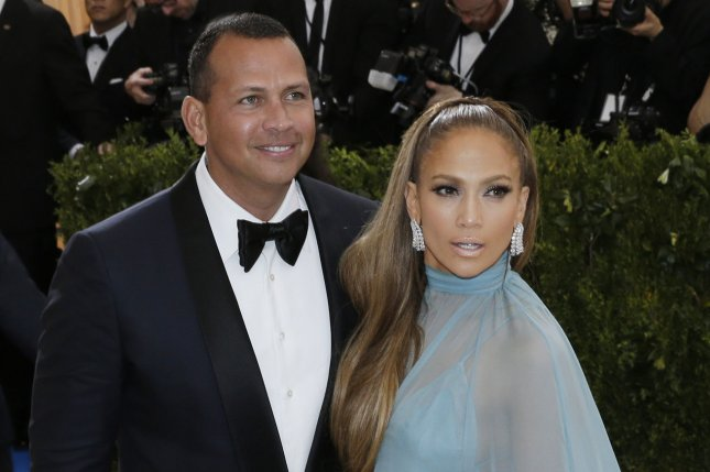 Alex Rodriguez (L), pictured with Jennifer Lopez, recalled his first encounter with the star in a new interview. File Photo by John Angelillo/UPI