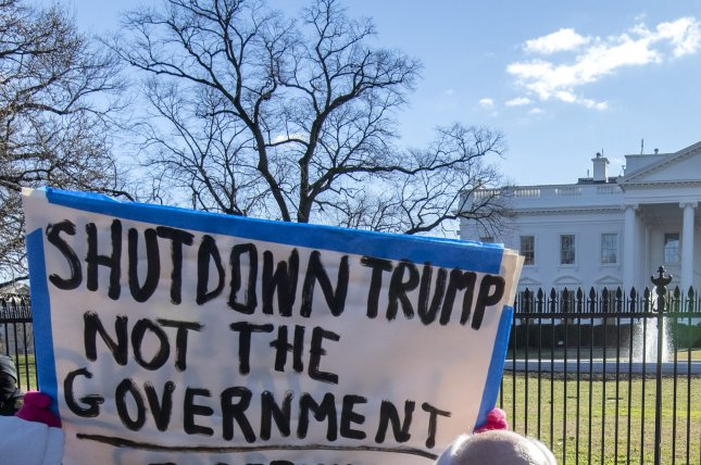 Members and supporters of the AFL-CIO labor union protest against President Donald Trump and the partial federal government shutdown in front of the White House in Washington, D.C., on Thursday. Photo by Pat Benic/UPI